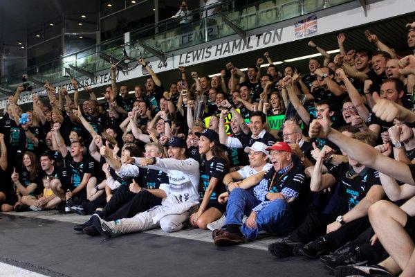 Yas Marina Circuit, Abu Dhabi, United Arab Emirates. Sunday 23 November 2014. Lewis Hamilton, Mercedes AMG, 1st Position, celebrates 2014 Championship victory with his team. World Copyright: Andrew Ferraro/LAT Photographic. ref: Digital Image _MG_1542