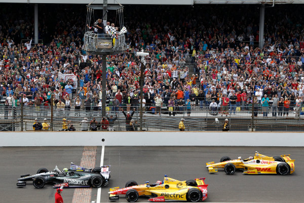 26 May, 2013, Indianapolis, Indiana, USA Tony Kanaan wins the Indy 500, followed by Carlos Munoz and Ryan Hunter-Reay checkered flag ©2013, Todd Davis LAT Photo USA