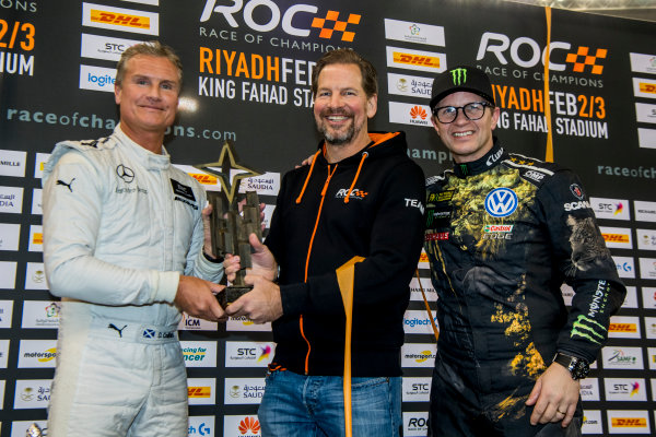 2018 Race Of Champions King Farhad Stadium, Riyadh, Abu Dhabi. Saturday 3 February 2018 Winner David Coulthard (GBR) is presented with his trophy on the podium. Copyright Free FOR EDITORIAL USE ONLY. Mandatory Credit: 'Race of Champions'