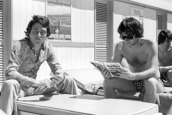 (L to R): Patrick Depailler (FRA) Tyrrell relaxes by the pool with Jean-Pierre Jarier (FRA) Shadow. Argentinean Grand Prix, Rd1, Buenos Aires, Argentina, 13 January 1974.