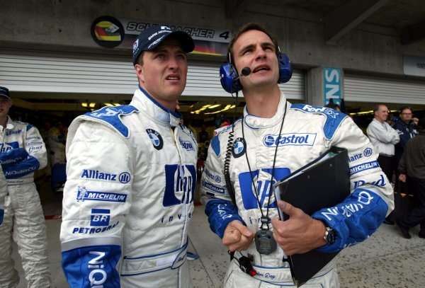 (L to R): Ralf Schumacher (GER) Williams and Gordon Day (GBR) Williams Race Engineer.