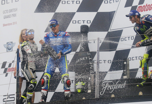 2016 MotoGP Championship.  British Grand Prix.  Silverstone, England. 2nd - 4th September 2016.  Maverick Vinales, Suzuki, Cal Crutchlow, LCR Honda, and Valentino Rossi, Yamaha, celebrate on the podium.  Ref: _W7_9523a. World copyright: Kevin Wood/LAT Photographic