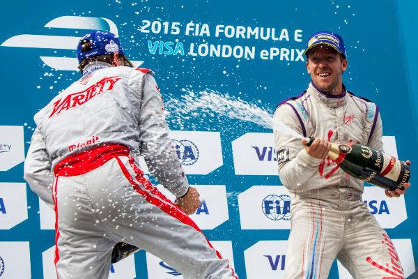 2014/2015 FIA Formula E Championship. London e-Prix, Battersea Park, London, UK. Sunday 28 June 2015. Sam Bird (GBR)/Virgin Racing - Spark-Renault SRT_01E and Jerome D'Ambrosio (BEL)/Dragon Racing - Spark-Renault SRT_01E on the podium. World Copyright: Zak Mauger/LAT Photographic/Formula E. ref: Digital Image _MG_0215