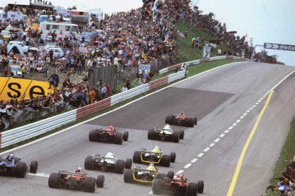 Osterreichring, Zeltweg, Austria. 10 - 12 August 1979.Gilles Villeneuve (Ferrari 312T4), 2nd position, leads Alan Jones (Williams FW07 Ford), 1st position and Niki Lauda (Brabham BT48 Alfa Romeo), retired, at the start, action. World Copyright: LAT Photographic.Ref:  79AUT13