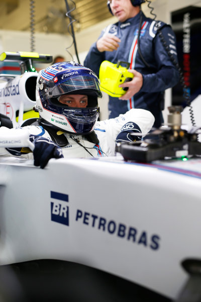 Sochi Autodrom, Sochi, Russia. Friday 09 October 2015. Valtteri Bottas, Williams FW37 Mercedes climbs into his car in the garage. World Copyright: Glenn Dunbar/LAT Photographic. ref: Digital Image _89P8984