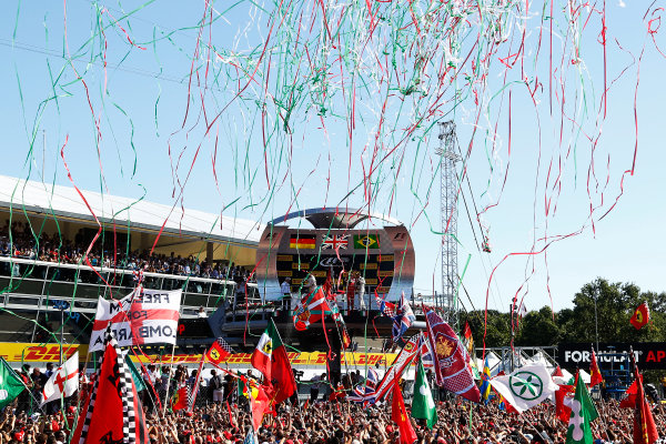 Autodromo Nazionale di Monza, Monza, Italy. Sunday 6 September 2015. Streamers fall in celebration at the podium ceremony after the race. World Copyright: Jed Leicester/LAT Photographic ref: Digital Image _L2_9344