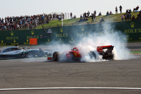 Sebastian Vettel (GER) Ferrari SF-71H spins after clashing with Max Verstappen (NED) Red Bull Racing RB14 as Lewis Hamilton (GBR) Mercedes-AMG F1 W09 EQ Power+ passes