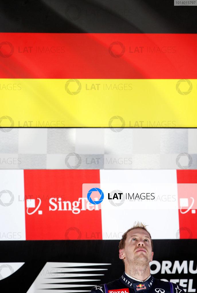 Marina Bay Circuit, Singapore. Sunday 22nd September 2013.  Sebastian Vettel, Red Bull Racing, while the German national anthem plays again.  World Copyright: Glenn Dunbar/LAT Photographic. ref: Digital Image _89P1274