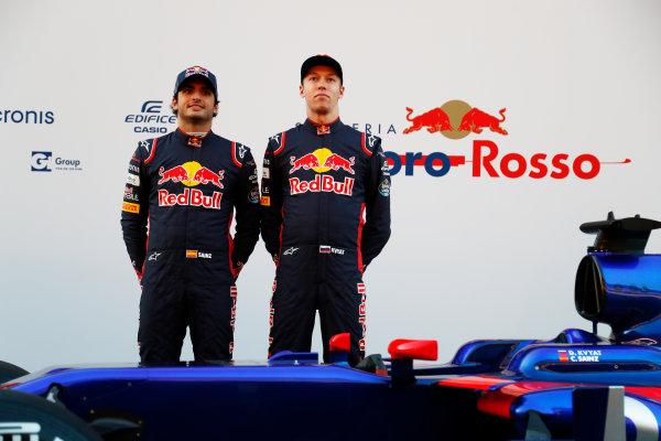 Toro Rosso STR12 Formula 1 Launch. Barcelona, Spain  Sunday 26 February 2017. Carlos Sainz Jr, Toro Rosso. and Daniil Kvyat, Toro Rosso.  World Copyright: Dunbar/LAT Images Ref: _X4I9466