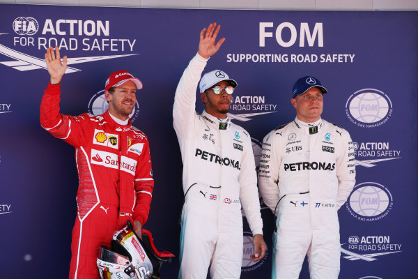 Circuit de Catalunya, Barcelona, Spain. Saturday 13 May 2017. Top three qualifiers Lewis Hamilton, Mercedes AMG, Sebastian Vettel, Ferrari, and Valtteri Bottas, Mercedes AMG. World Copyright: Charles Coates/LAT Images ref: Digital Image DJ5R8880