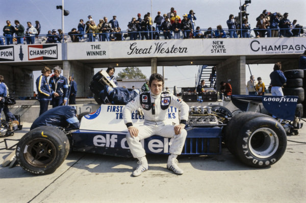 Patrick Depailler sits on his Tyrrell 008 Ford in the pits.
