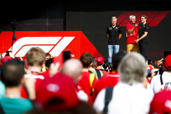 Kevin Magnussen, Haas F1 and Romain Grosjean, Haas F1 on stage in the fan zone