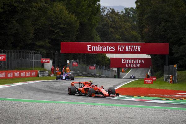Charles Leclerc, Ferrari SF90, leads Pierre Gasly, Toro Rosso STR14