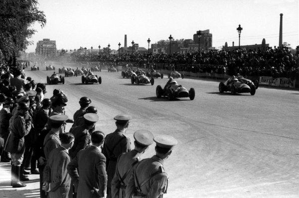 2003 Racing Past... Exhibition 1951 Spanish Grand Prix, Pedralbes. Alberto Ascari (Ferrari 375F1) leads at the start. World Copyright - LAT Photographic Exhibition ref: a017 Ref: 51/65#14