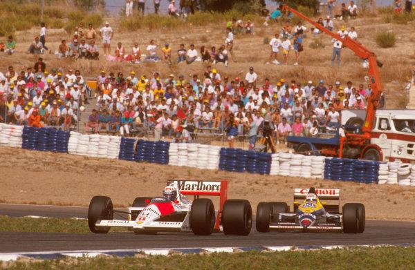 Jerez, Spain.30/9-2/10 1988.Alain Prost (McLaren MP4/4 Honda) 1st position, with Nigel Mansell (Williams FW12 Judd) behind.Ref-88 ESP 14.World Copyright - LAT Photographic