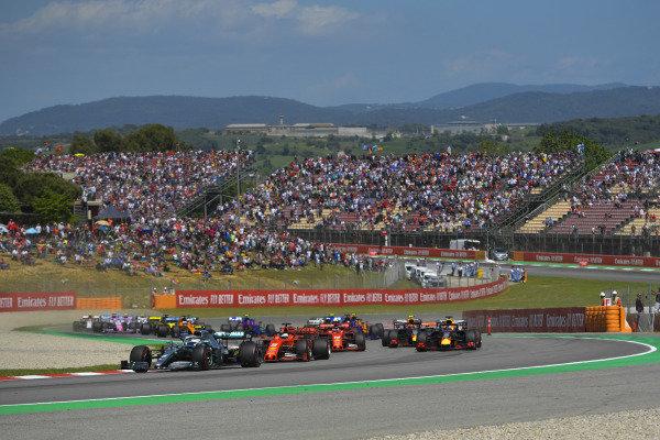 Valtteri Bottas, Mercedes AMG W10, leads Sebastian Vettel, Ferrari SF90, Charles Leclerc, Ferrari SF90, Max Verstappen, Red Bull Racing RB15, and the remainder of the field at the start