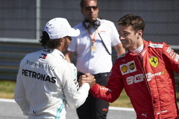 Lewis Hamilton, Mercedes AMG F1, congratulates pole man Charles Leclerc, Ferrari