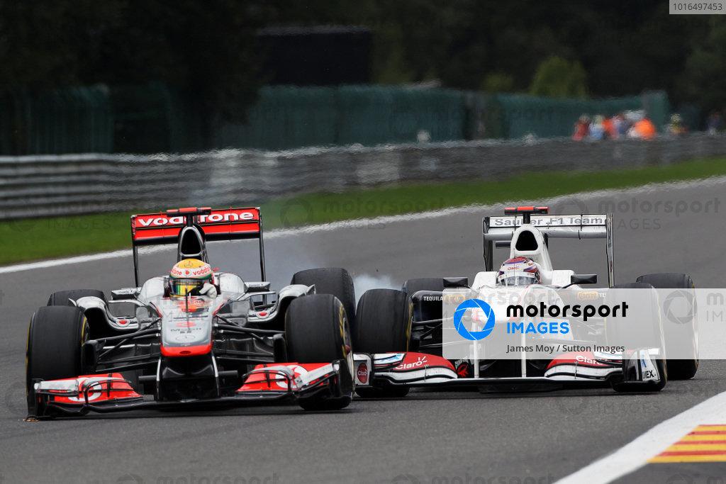 (L to R): Lewis Hamilton (GBR) McLaren MP4/26 and Kamui Kobayashi (JPN) Sauber C30 collide at Les Combes. Formula One World Championship, Rd 12, Belgian Grand Prix, Race, Spa-Francorchamps, Belgium, Sunday 28 August 2011.  BEST IMAGE