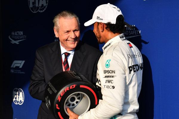 Lewis Hamilton, Mercedes AMG F1, receives the Pirelli Pole Position Award from former world champion Alan Jones