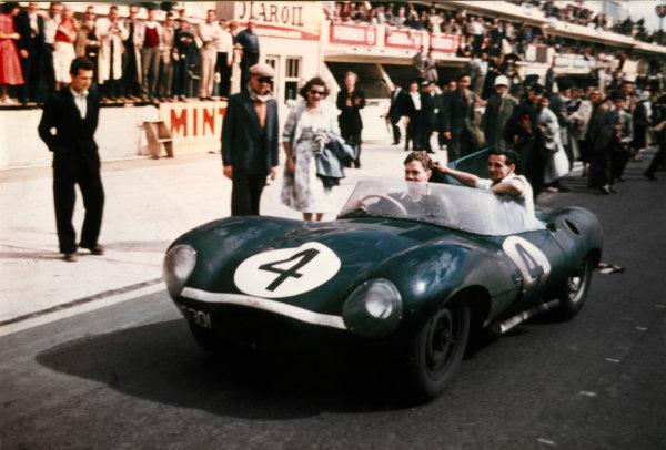 Le Mans, France. 28th - 29th July 1956 Ninian Sanderson/Ron Flockhart (Jaguar D-type), 1st position, drives into parc ferme, action. World Copyright: LAT Photographic Ref: Colour Print.